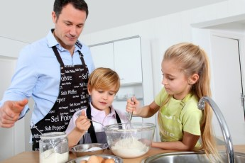 dad and kids cooking together